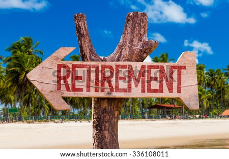 Retirement arrow with beach background - stock photo