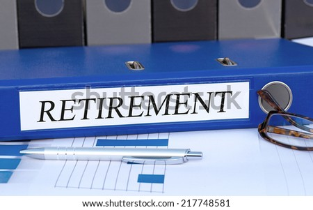 Retirement - blue binder in the office - stock photo