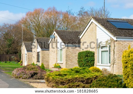 Retirement bungalows in a suburban UK neighbourhood in spring - stock photo