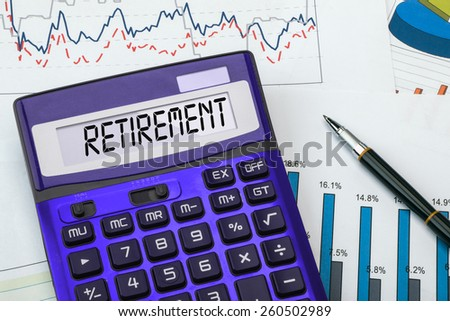 retirement concept displayed on calculator - stock photo