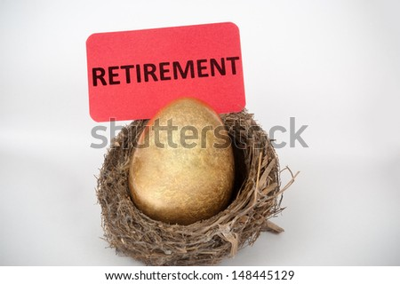 Retirement concept with golden egg in the bird nest - stock photo