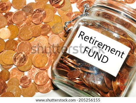 Retirement fund concept with jar of money and coins - stock photo