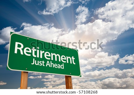 Retirement Green Road Sign with Dramatic Clouds, Sun Rays and Sky. - stock photo
