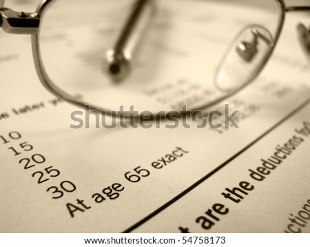 Retirement image of pension plan form with glasses and pen - stock photo