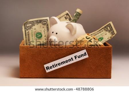 Retirement Money in a Box. - stock photo