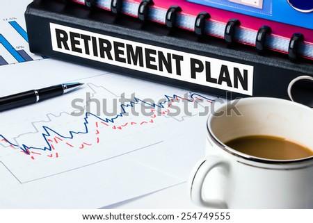 retirement plan label on document folder - stock photo