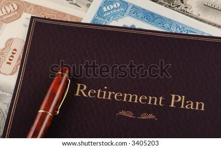 Retirement Plan on top of vintage stock certificates - stock photo