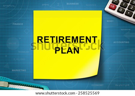 Retirement plan text on yellow note with graph paper - stock photo