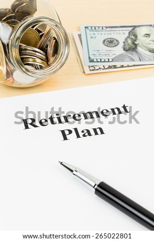 Retirement plan with banknote, coin jar, and pen - stock photo