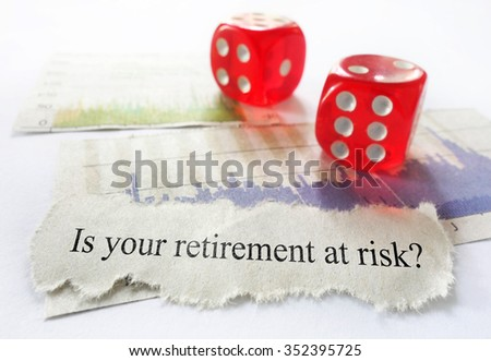 Retirement risk news headline with dice and stock market charts                                - stock photo