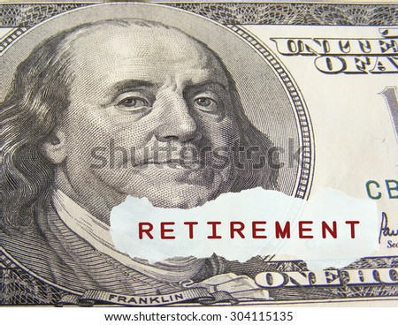 Retirement text on a paper scrap over one hundred dollar on foreground - stock photo