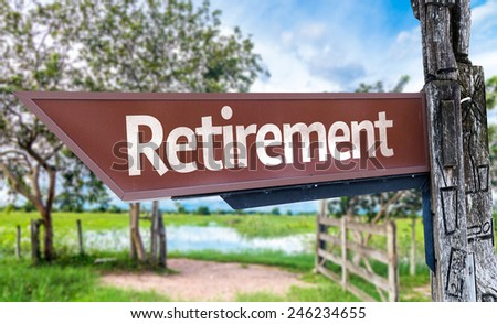 Retirement wooden sign with rural background - stock photo