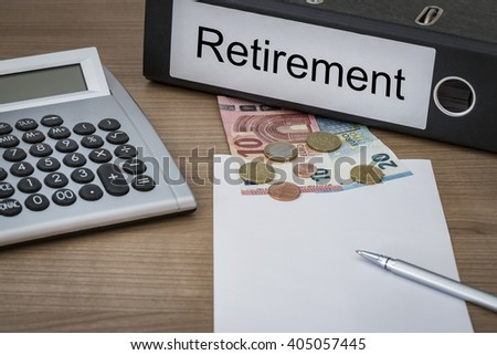 Retirement written on a binder on a desk with euro money calculator blank sheet and pen