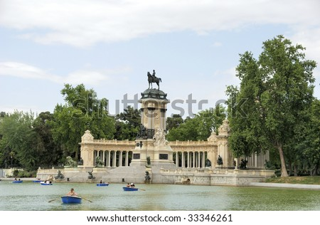 Retiro Park with the Alfonso Monument and the lake in Madrid, Spain