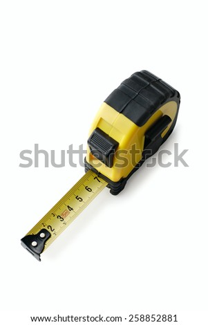 Retractable tape measure with a centimeter scale viewed high angle on white in a household object and construction concept