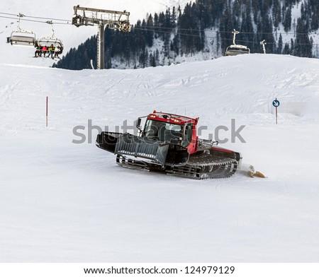 Retrak levels the route of mountain-skiing descent in Penken region - Mayrhofen, Austria - stock photo