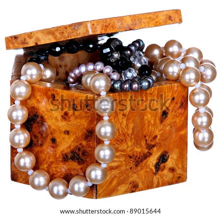 Retro a casket with jewelry . Beads from pearls In a casket from wood of the Karelian birch isolated on a white background . - stock photo