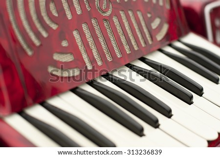Retro accordion keyboard.  Red accordion - stock photo
