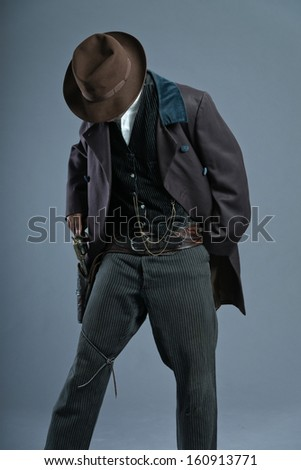 Retro Afro america western cowboy man with mustache. Ready to shoot. Wearing brown hat. Cool tough guy. - stock photo