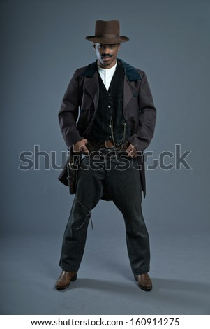 Retro Afro america western cowboy man with mustache. Wearing brown hat. Cool tough guy. - stock photo