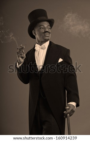Retro afro american dickens scrooge man with mustache. Wearing black hat. Smoking a cigar.