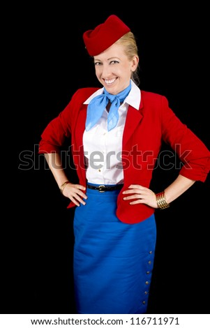 Retro Airline Attendant Isolated on Black. - stock photo
