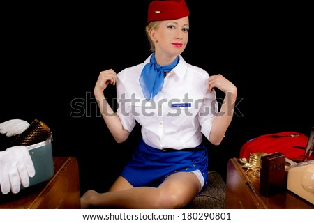 Retro Airline Stewardess or Flight Attendant After Removing Her Jacket. - stock photo