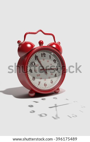 Retro Alarm Clock A red, retro style, alarm clock. Isolated on white. 3d render - stock photo