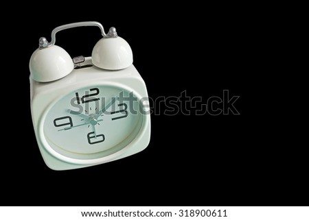Retro alarm clock isolated on black background with copy space. Retro style. - stock photo
