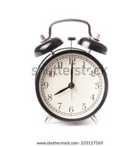 Retro alarm clock on isolated white background - stock photo