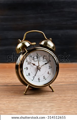 retro alarm clock on table - stock photo