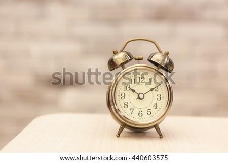 Retro alarm clock showing the romance time. - stock photo