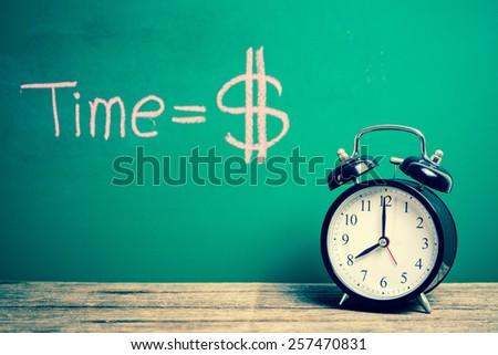 Retro alarm clock with green board, vintage tone  - stock photo