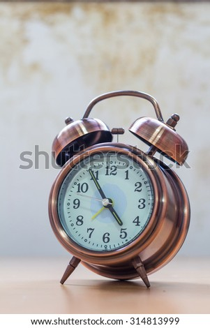 Retro alarm clock with old wall