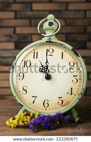 Retro alarm on table, close up - stock photo