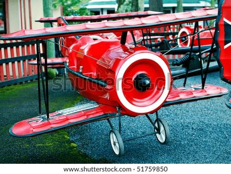 Retro Amusement Airplane Ride - stock photo