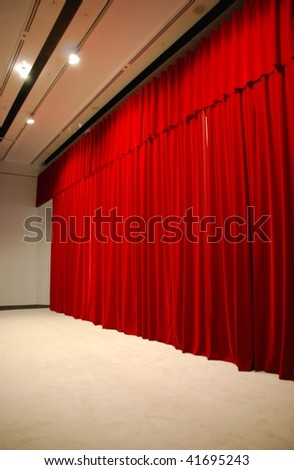 retro and elegant red theater stage curtains and stage - stock photo