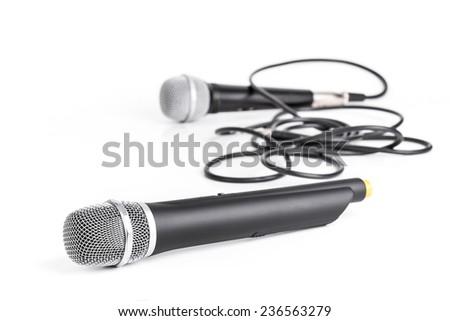 Retro and modern wireless microphone closeup on white  - stock photo