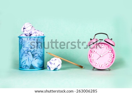 retro and vintage style of Old fashioned the alarm clock and clumpled peper waste  idea - stock photo