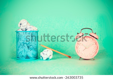 retro and vintage style of Old fashioned the alarm clock and crumpled paper waste  idea - stock photo