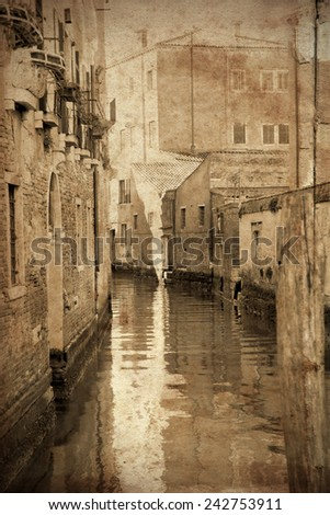 Retro and vintage styled view of channels of the romantic city of Venice, Italy. Grunge texture applied as background - stock photo