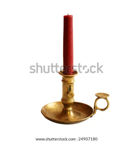 Retro antique brass candlestick with red candle - stock photo