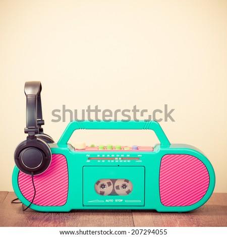 Retro aquamarine radio cassette recorder from the 80s, headphones - stock photo