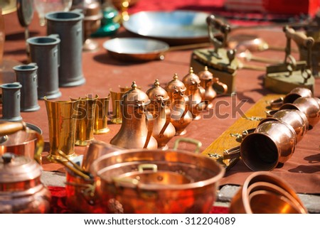 Retro arabic copper coffee pots, jugs, pitchers and other old things - stock photo
