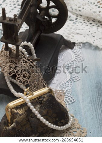 retro arrangement with sewing machine and female accessories - stock photo