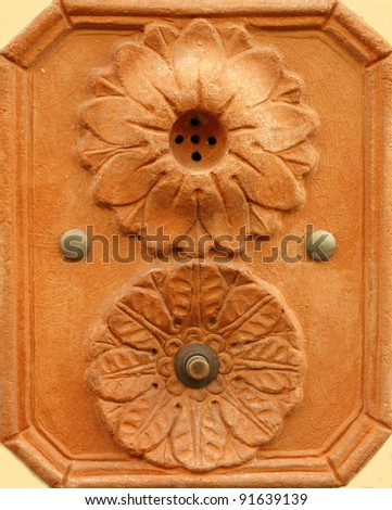 retro artistic doorbell made in terracotta from Tuscany, Impruneta, Italy, Europe - stock photo