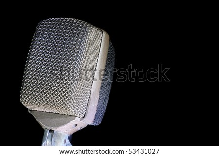 Retro audio microphone on black background.