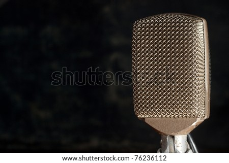 Retro audio microphone on dark background