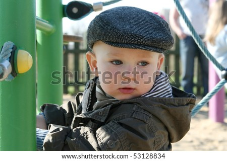 Retro baby. 18 months old baby boy and cloth cap. - stock photo