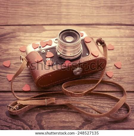 Retro backgroung camera, vintage item - stock photo